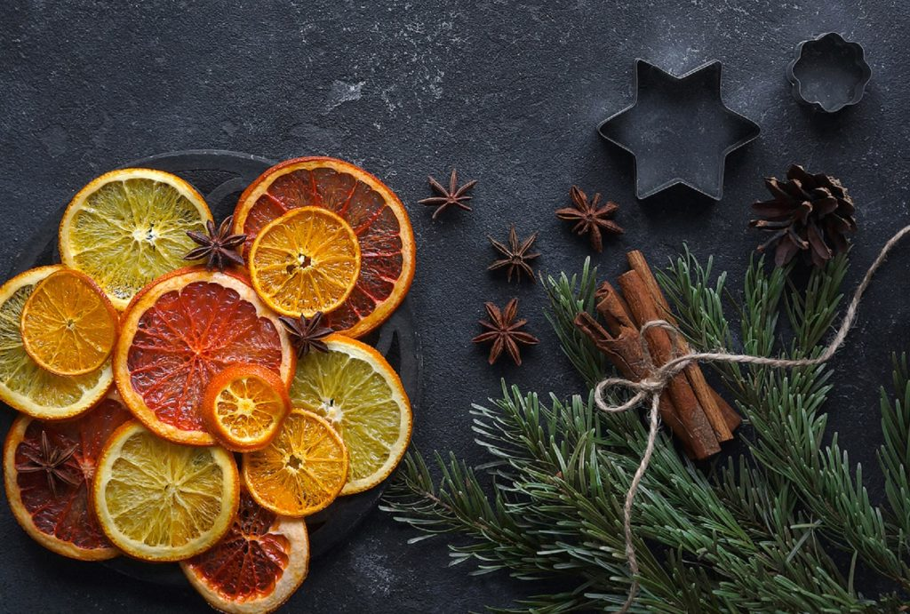 Caramelized citrus on a dark background, Mulled wine ingredients, Top view, Copy space, Vertical